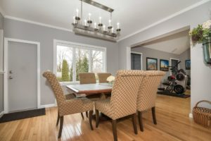 picture of dining room with high back chairs,